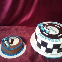 Indy Car Birthday Cake Smash cake is chocolate with fudge buttercream. The bigger cake is marble with fudge buttercream filling and covered in vanilla buttercream...