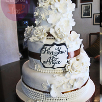 3 Tier White Wedding Cake Decorated With Beads Roses Blossoms And Handwritten Plaque Simple And Elegant 3-tier white wedding cake decorated with beads, roses, blossoms and handwritten plaque. Simple and elegant