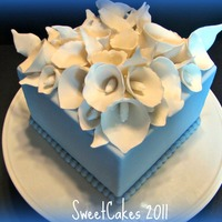 Calla Lily Bridal Shower Cake The bride loves calla lilies and cornflower blue, so that's what she's getting. This is my practice cake because I've never...