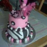 Birthday Cake buttercream and fondant with feathers