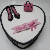 Thea Little shoes and couture bag on heart shaped cake