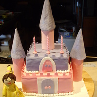 Princess Dora Cake Princess Dora cake made for a 3 year old. My first castle cake. Bottom layer was rainbow and looked awesome. Top layer was choc mud for...