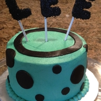 Black And Turquoise Polka Dots Buttercream with fondant accents