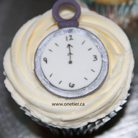 Clock Inspiration Challenge  This was part of a set of New Year's Eve cupcakes I made. Champagne flavored cupcake with champagne flavored buttercream with fondant...