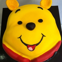 Winnie The Pooh, Face Cake. Chocolate cake and caramel filling with butter cream, fondant. 25 cm diameter cake, airbrushing only with (Rainbow dust-Plain and Simple...