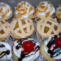 A Delicious Assortment   All white cake, all vanilla buttercream - apple pie filling, caramel drizzle, sundae style