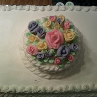 "Happy Mothers Day 1/2 sheet cake with a 6"" topper covered in fondant flowers."