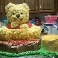 "Poohs First Birthday 1st Birthday cake, Pooh Bear on a tree stump eating ""hunny"". ""Hunny"" pot is the smash cake"