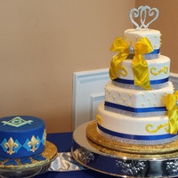 Royal Blue Yellow And White Wedding Cake With Grooms Cake Royal blue, yellow and white wedding cake, with groom's cake.