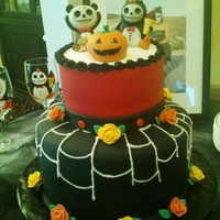 Halloween Wedding Cake Jack 'o lantern and roses are made of fondant. Toppers were provided by bride and groom.