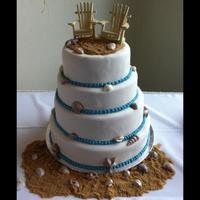 Beach Wedding  This is a 4 tier beach theme wedding cake.....all the shells i made with chocolate. Sand is brown sugar. I am very happy with how it turned...