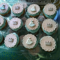 Cinderella Cupcakes Cupcakes I made to accompany one of the cinderella cakes I made. The pink is fondant cut with a cookie cutter and then I used the tip of a...