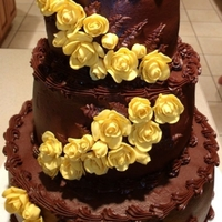 Chocolate Cake With Yellow Roses My very first stacked cake. It was chocolate cake, filled with whipped chocolate and raspberries, covered with chocolate fudge and...