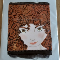 Brave  Banana cake covered in ganache. Image hand painted on fondant. Merida has brown hair and eyes to make her look like the birthday girl. TFL...