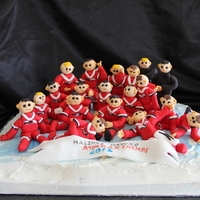 Kids' Hockey Team Cake I made the entire kids' hockey team in little fondant figurines....it was on a 24 x 24 slab.....each player had their name on their...