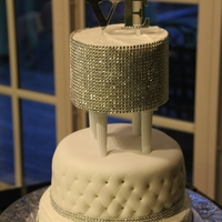 Glamour Wedding = Bling I made this wedding cake for a g/f at work. She wanted lots of bling. Top tier is covered in rhinestones...with mirrored topper...I covered...