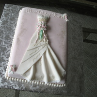 Replica Of Bride's Dress Asked to do a cake for a bridal shower making a copy of the bride's dress. Everything made with fondant. Request was for a white...