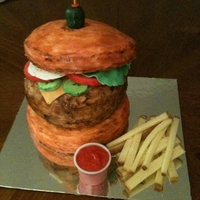Cheeseburger And Fries butter cream, toppings are fondant and icing ketchup. Fries are poundcake.