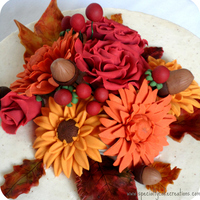 Fall Flowers Anniversary Cake Colorful fall flower bouquet on a 50. wedding anniversary cake. I made golden yellow gerbera daisies, chrysanthemum in burnt orange, and...