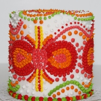 "Dots And Dots This is a mini cake 4"". Decorated with dots and bright colors."