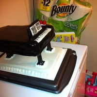 Baby Grand Piano My husband is a piano player. Made this cake for him for his birthday. Used black fondant - the base is also cake covered with white MMF.