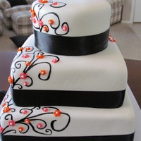 1319420710.jpg My first wedding cake :) Highlighted with orange and pink flowers