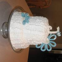 White Ruffle Cake Made for a girl's birthday/baptism. Ruffles are buttercream and flowers and letter are gumpaste.