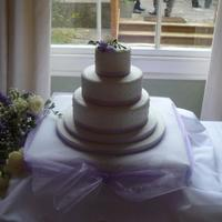 Lilac Wedding Cake This is my first wedding cake I have completed for a friends recent wedding. All tiers rich chocolate fudge cake with white chocolate...