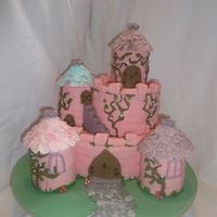 Princess Castle I made this cake for my daughters 5Th birthday. Thanks to sanmarco5 for the idea. I added the addition of the iced board and pebble path (...