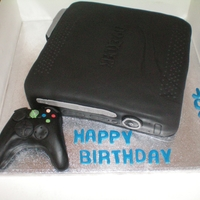 Xbox Xbox cake, chocolate pound cake with vanilla buttercream, covered in sugarpaste, control is sugarpaste.