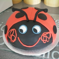 Ladybug This is supposed to be Gaston from Ben and Holly, for my 2 yr old niece., Choc cake, sugarpaste