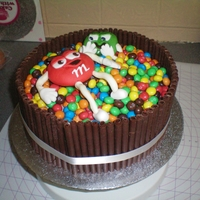 M&m's For my brother, choc cake, choc filling, covered in sugarpaste and m&ms and choc cigerellos. All edible