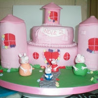 Peppa Pig Castle Pink castle, peppa pig family. Vanilla cake and jam, cream filling. Sugarpaste, everything edible.