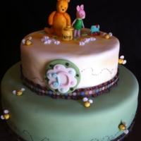 Classic Pooh   Fondant covered cake with fondant figures hand crafted figures.