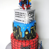 Spiderman Cake A Spiderman cake for a special little boy: classic chocolate cake filled with cookies 'n cream buttercream and milk chocolate ganache...