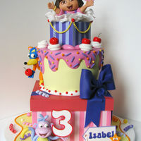 "Dora Cake A Dora cake for my daughter! Cake is 8"" square, 7"" tapered, 4"" square with gumpaste Dora, Boots and Swiper. We couldn't..."