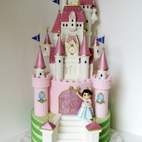 "Princess Pink Castle Cake I think every mom dreams of making a pretty castle cake for their little girl. So much fun to make! 12"" stylized grass tier, 8""..."