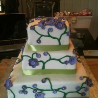 Michelle's L. Wedding Cake bride specifically wanted these colors light green dark green, light purple and dark purple.