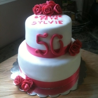 Sylvie's 50Th Bday coral color theme; flowers in fondant, the writting melted a bit should of used buttercream and not gel.