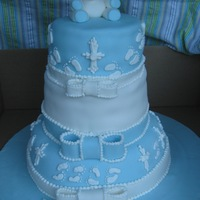 Heith's Baptism Cake 3 tierstop-choc/choc buttercream, middle-vanilla/vanilla custard, bottom-red velvet/cream cheese frosting.