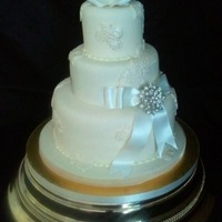 Bridal Lace Each tier is a different flavoured cake - vanilla, Rum Carrot and Coconut & Lime. I loved making this cake :)