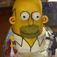 Homer Simpson Cake Homer Simpson cake. 4 flavor inside covered in butter cream, the ears are fondont