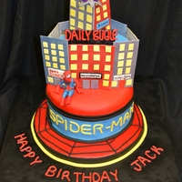 Spiderman Spiderman cityscape scene with Daily Bugle and green goblin. Chocolate cake covered with fondant. Details made with gumpaste except Green...