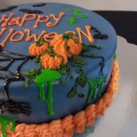 Happy Halloween Pumpkins,spiders And Bats....  vanilla cake with raspberry filling and buttercream covered in fondant with buttercream and royal icing accents. spiders and bats are...