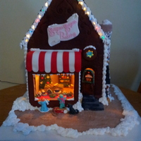 Gingerbread Bakery   our gingerbread bakery for Festival of TRees here in saskatoon. everything is edible(with the exception of the lights and window.
