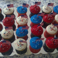Americana Cupcakes Yellow cupcakes with buttercream frosting.