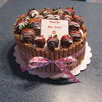 Chocolate Covered Strawberry Cake I made this cake for my son's daycare teacher as an end of the year thank you. It is WASC cake with strawberry filling and buttercream...
