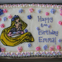 Rapunzel Birthday Cake Rapunzel cake is a 12x18 double layer chocolate cake with buttercream filling. Cakery inspired borders.