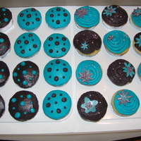 Eggplant, Teal And Silver Cupcakes These cupcakes are for a prom. They are all yellow cake with buttercream frosting, fondant flowers, and silver dragees.