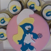 Smurfette Cake & Cupcakes   A gorgeous smurfette cake with cupcakes surrounding